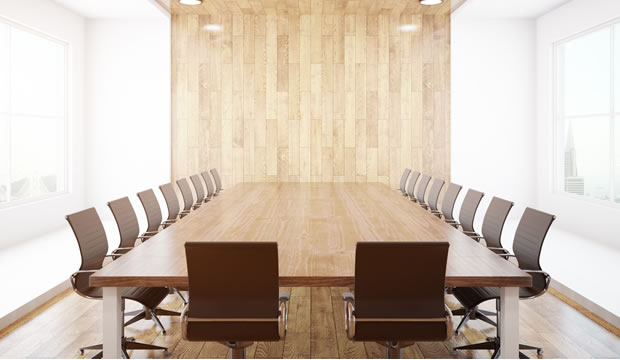 A formal commission boardroom setting.