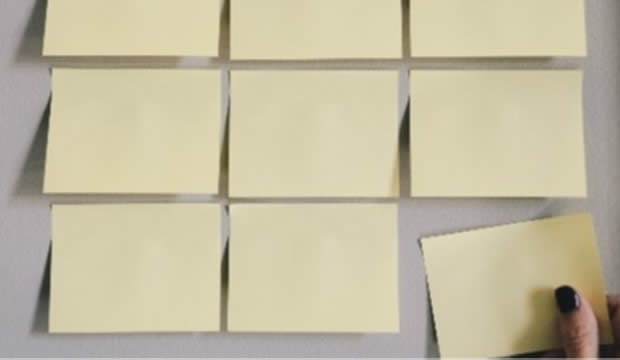 post it notes on a whiteboard